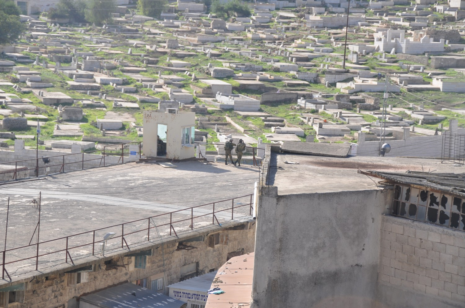 Soldiers guarding over the muslim cemetary